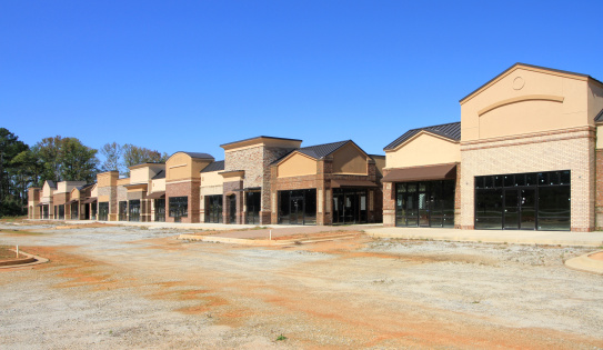 An unfinished shopping center sits abandoned.  A sign of bad economic times.