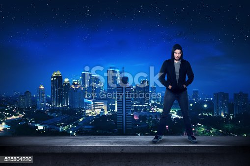 istock Bad guy standing on the building rooftop 525804220