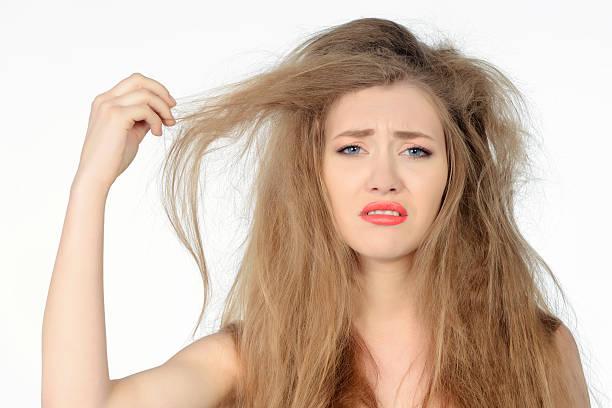 bad hair day woman expressing negativity - kabarık saç stok fotoğraflar ve resimler