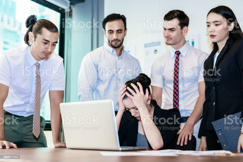 Bad investment or economic crisis concept. business woman is stress and disappointed from losing in stock exchange.Depressed with team staff royalty-free stock photo