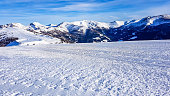 View on fog-covered valley in Bad Kleinkirchheim, Austria. Big ski resort. The slopes are perfectly gravelled. Lots of snow caped mountains. Winter sports in Alpine winter wonderland