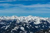Sunny winter day in the austrian alps in the ski resort of  Bad Kleinkirchheim, Austria. The snow shows a nice reflection. Winter sports in Alpine winter wonderland