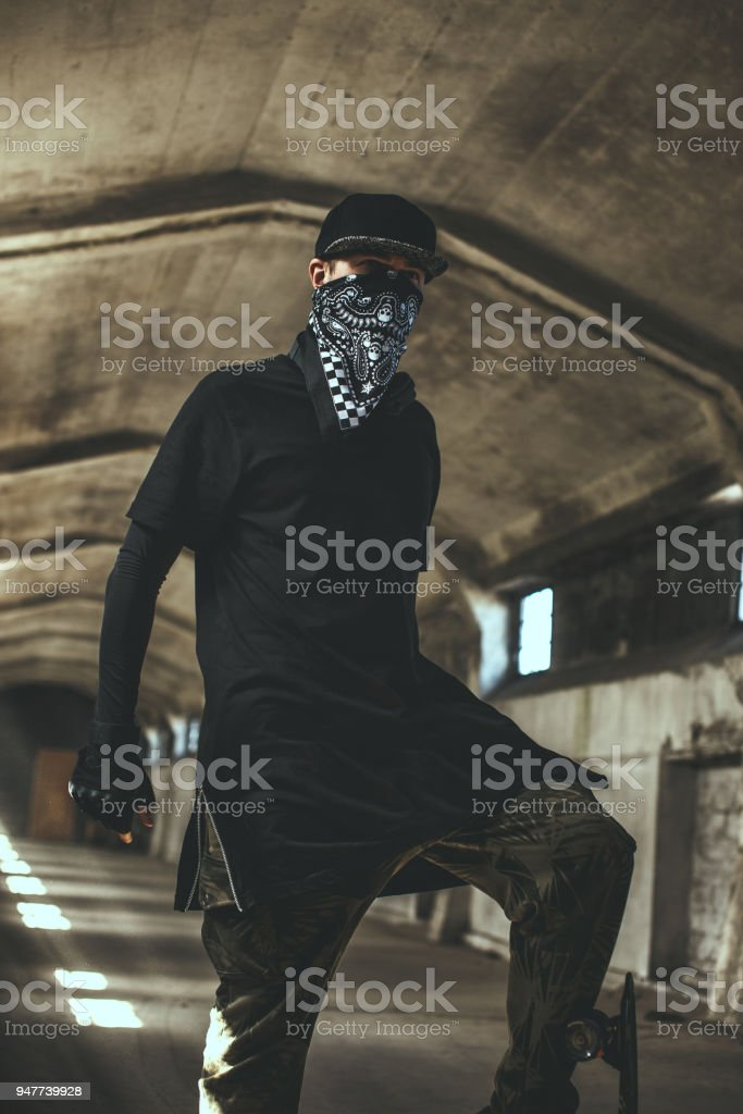 Bad male gangster in mask. stock photo