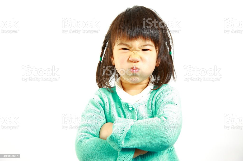 bad mood Japanese little girl stock photo