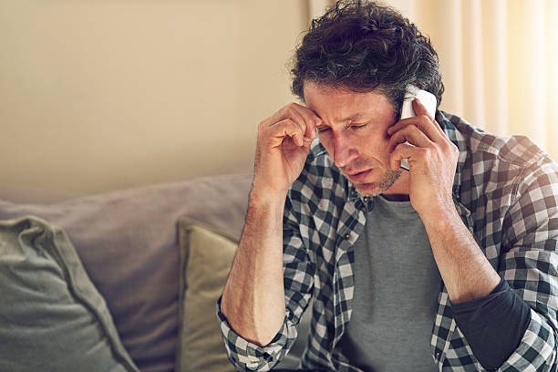 bad news comes calling - frustrated man stock photos and pictures