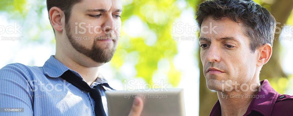Bad news on digital tablet panoramic close-up royalty-free stock photo