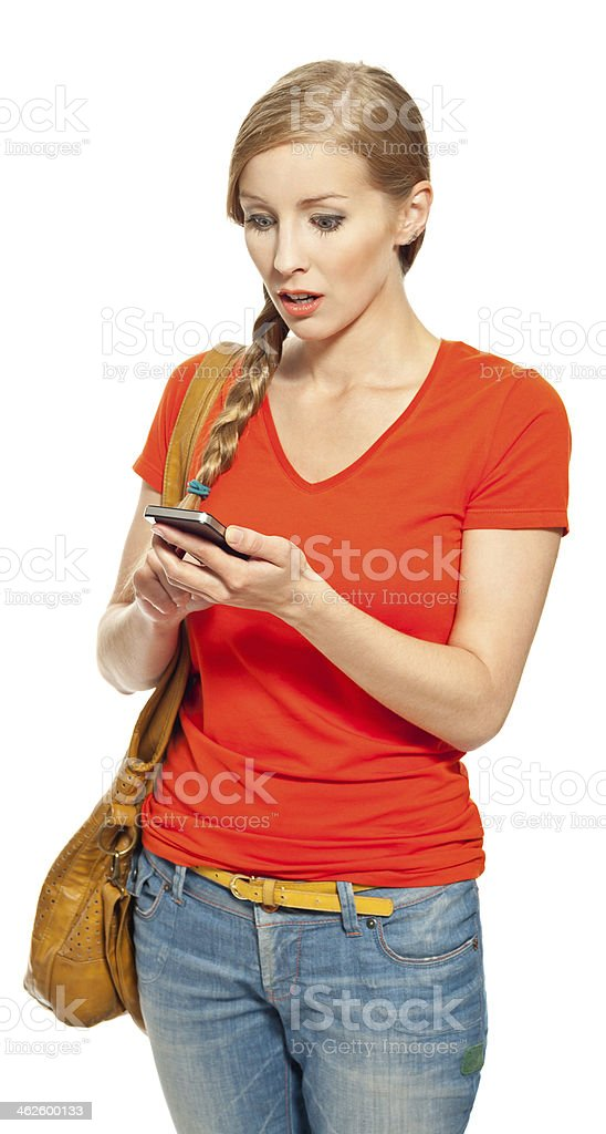 Bad news Portrait of shocked young woman looking at her smart phone. Studio shot, white background. 18-19 Years Stock Photo