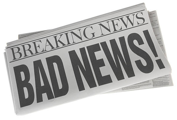 Bad News - Stock Image of Newspaper on White Bad News as a headline on a stack of folded newspapers isolated on white.  Stock photo of a headline on a pile of newspapers on white background.  All stories are my own.  All names are fictional. newspaper cutouts of bad news headlines stock pictures, royalty-free photos & images