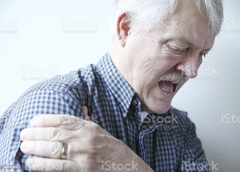 bad pain in shoulder of senior man stock photo