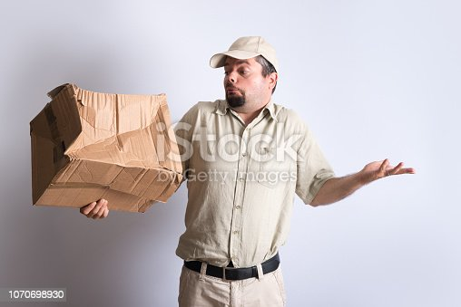 istock Bad Parcel Delivery 1070698930