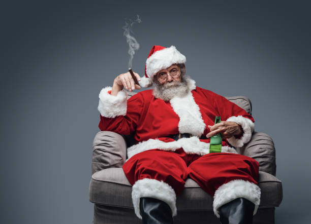 bad santa celebrating at home - rudeness stock pictures, royalty-free photos & images