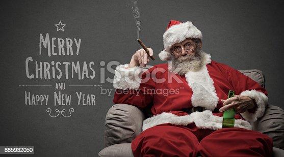 istock Bad Santa celebrating at home 885932050