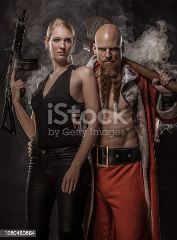 Bad Santa Claus with female gangster