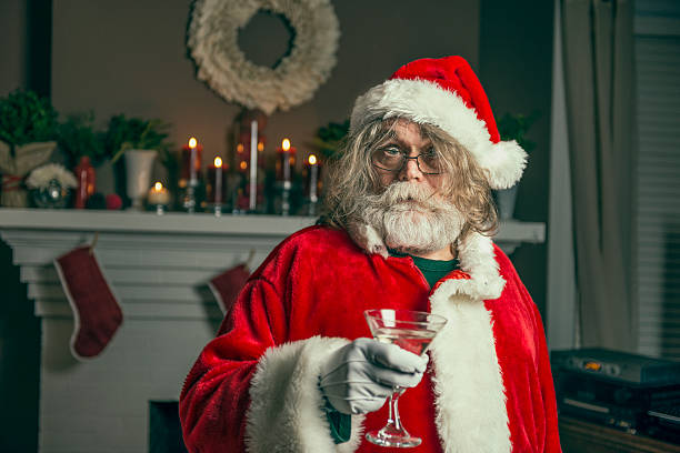 bad santa gets wasted - drunk stock photos and pictures
