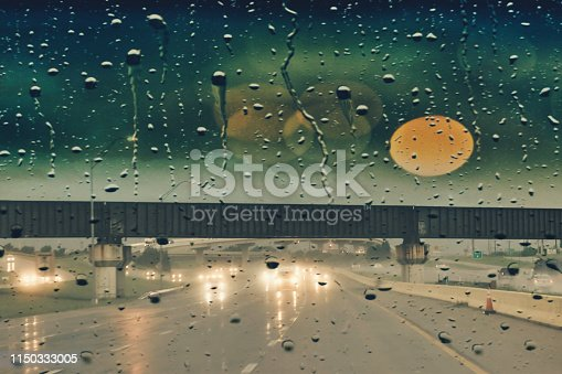 1054750504 istock photo Bad weather and rain on the freeway 1150333005