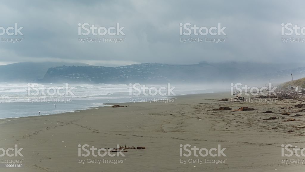 bad weather at the beach of christchurch stock photo