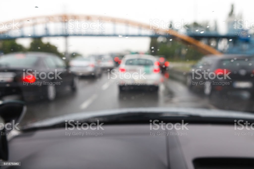 Bad weather driving car in traffic jam - blurred view royalty-free stock photo