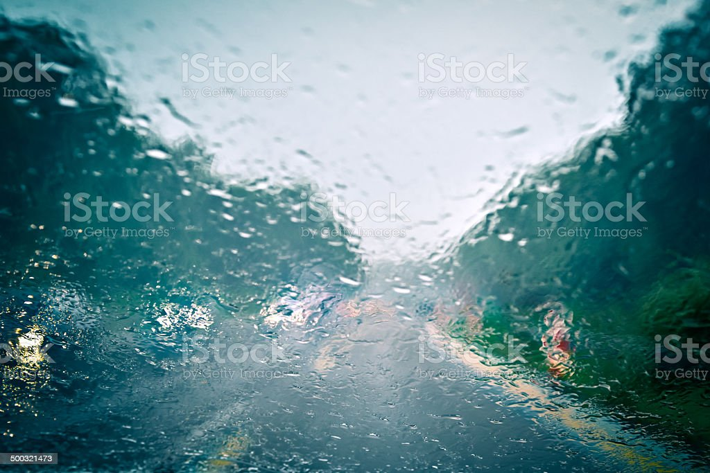 Bad weather driving - completely defocused stock photo