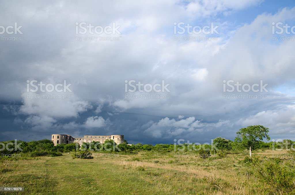 Bad weather is coming up at  a medieval castle ruin stock photo