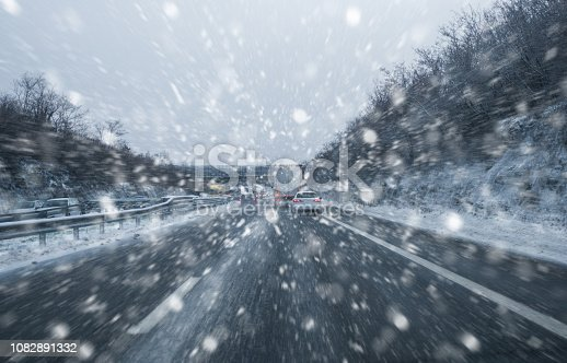 1127834626 istock photo Bad Weather on the highway - Blizzard on the Road and bad Visibility - All logo, company and car plate removed 1082891332