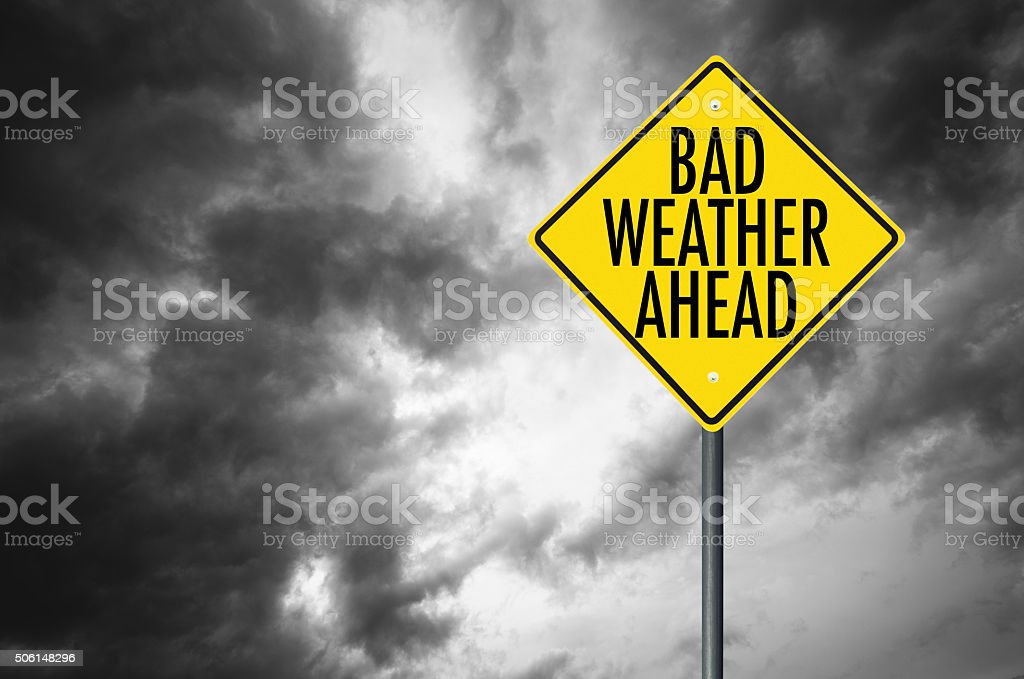 bad weather road sign stock photo
