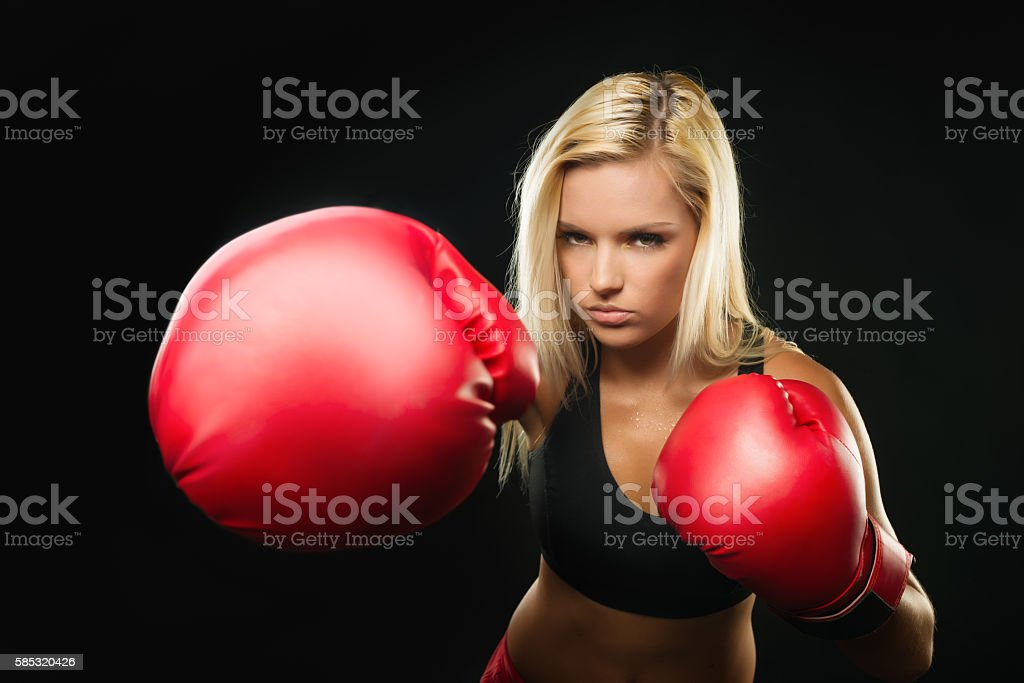 Badass Fitness Woman with Red Boxing Gloves is Attacking stock photo