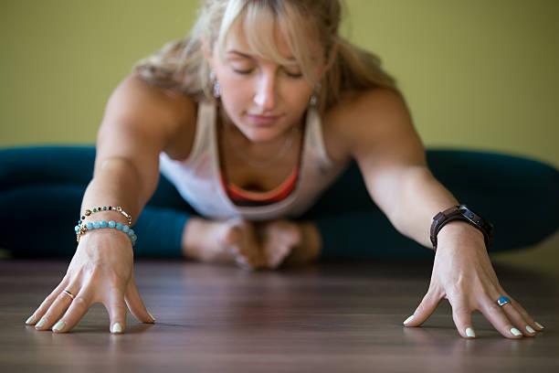 baddha konasana pose - yin yoga stock-fotos und bilder