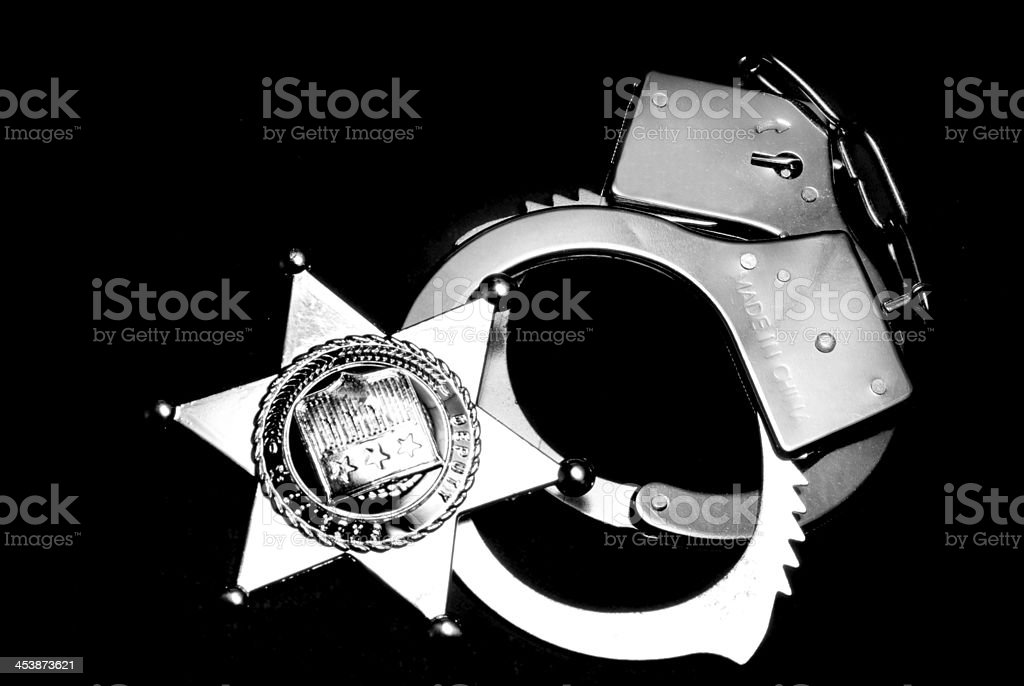 Badge and Handcuffs royalty-free stock photo