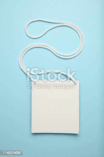istock Badge name tag, lanyard on blue background. Conference, event, convention vip pass 1145224097