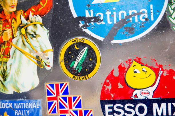 badges and stickers on lambretta windshield at the annual classic car exhibition and vintage clothing market at kings cross, london, england - rocket logo stock photos and pictures