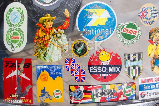 Badges and stickers on Lambretta windshield at the annual Classic Car Exhibition and Vintage Clothing Market at Kings Cross, London, England, April 28, 2018.
