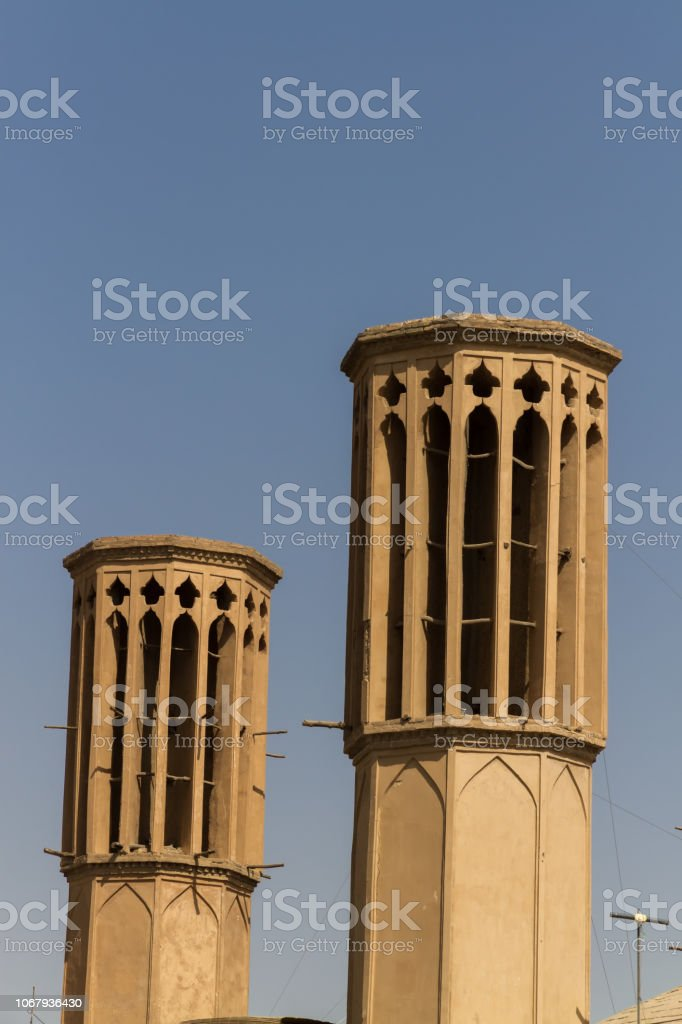 Badgirs, the cooling rooftop windtowers of desert city Yazd, Iran. stock photo