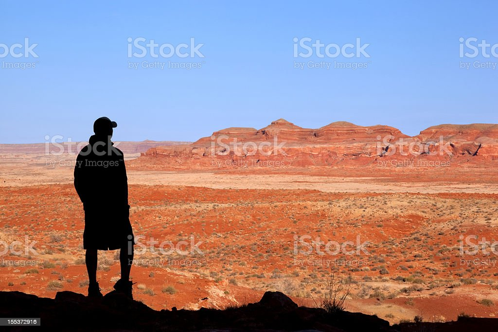 badlands silhouette man landscape royalty-free stock photo