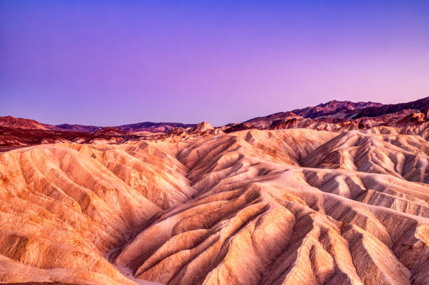 Badlands view from Zabriskie Point in Death Valley National Park at Dusk, California stock photo