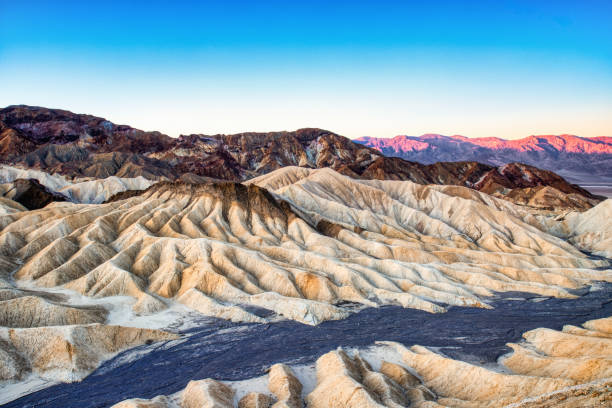 Badlands view from Zabriskie Point in Death Valley National Park at Sunset, California stock photo