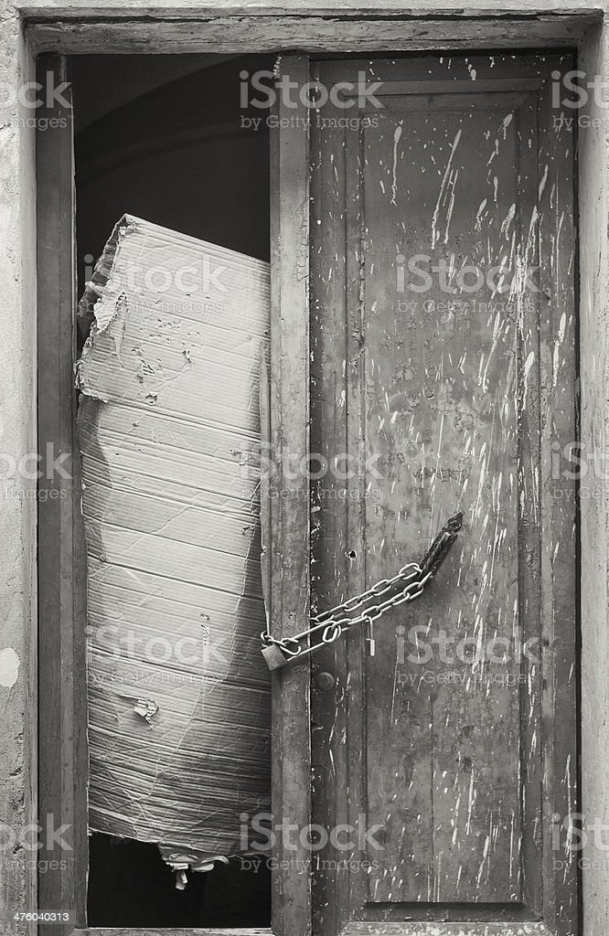 Badly closed and locked door royalty-free stock photo