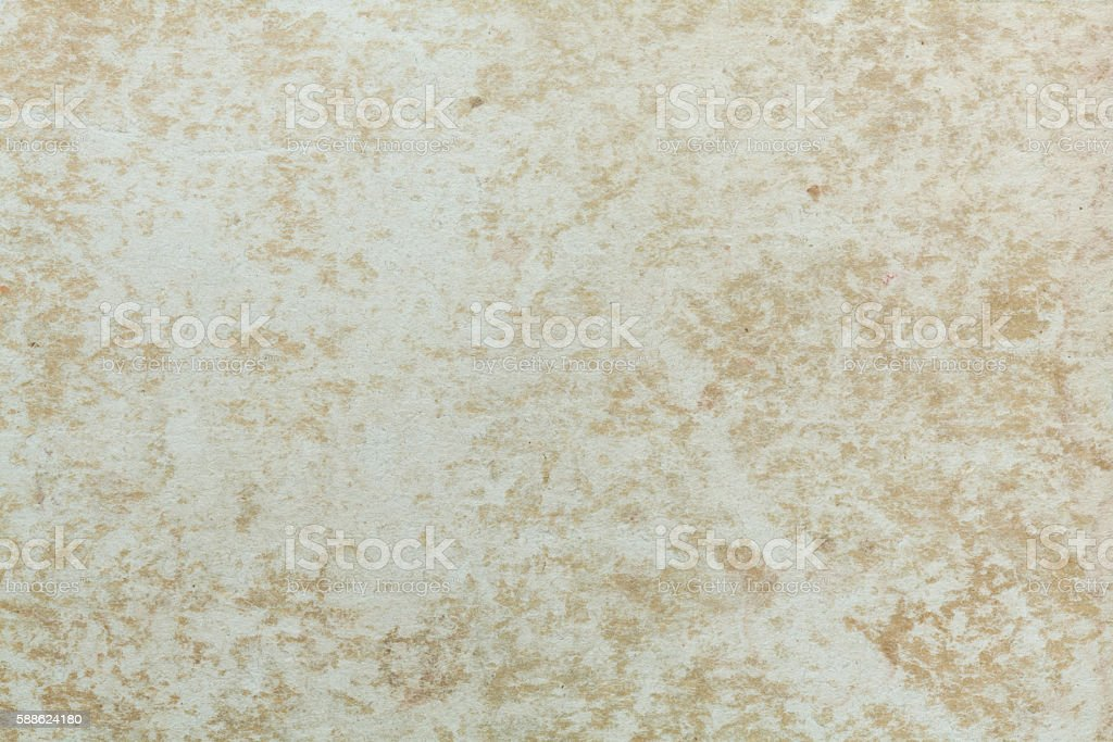 Badly damaged beige cardboard texture stock photo