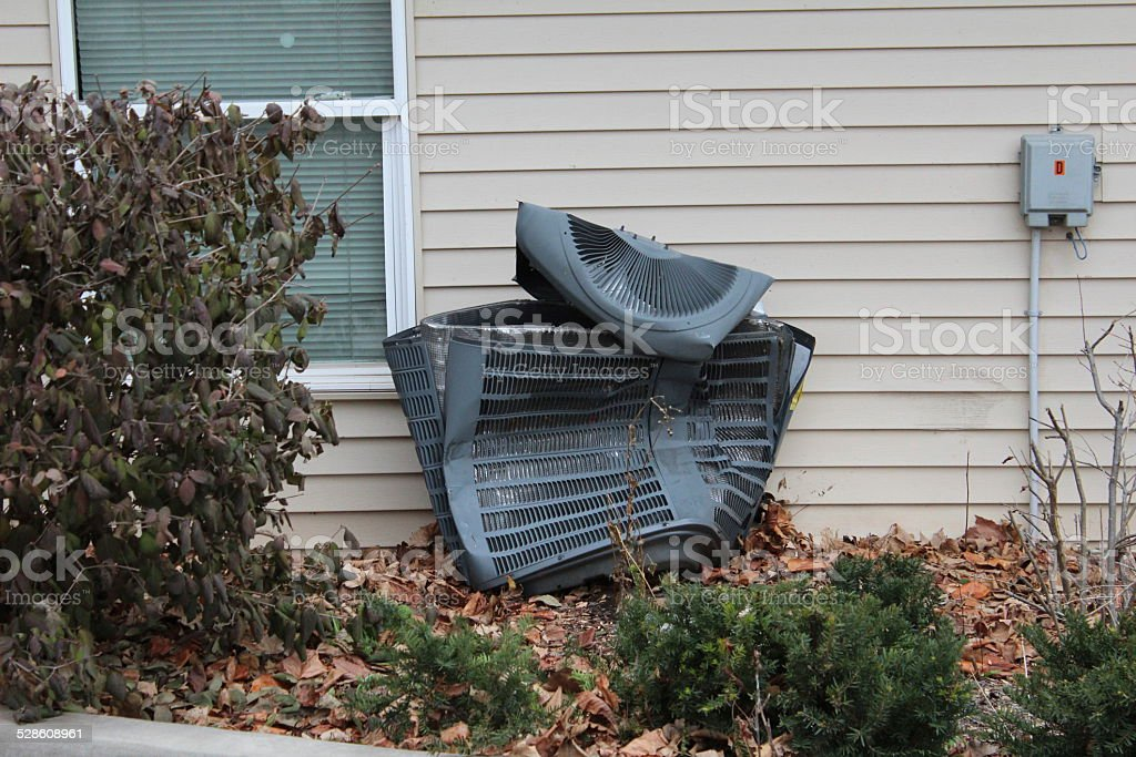 Badly damaged Central AC unit stock photo