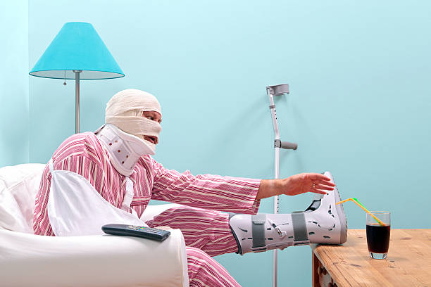 badly injured man recovering at home - broken leg stock photos and pictures
