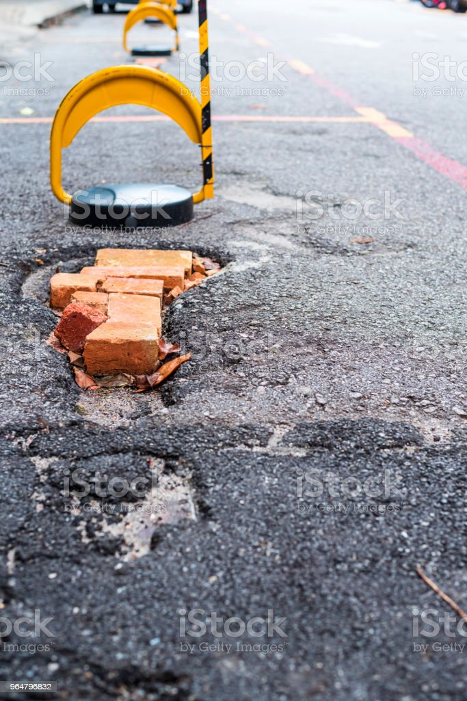 Badly repaired potholes royalty-free stock photo