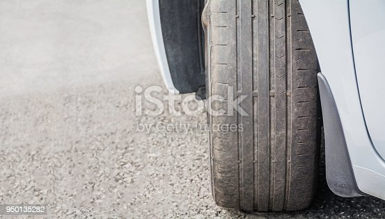 Worn Out and Damaged Car Tire.