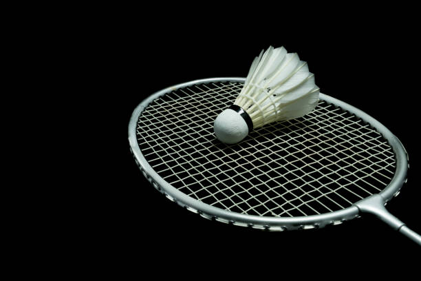 badminton ball on black background - badminton stock pictures, royalty-free photos & images