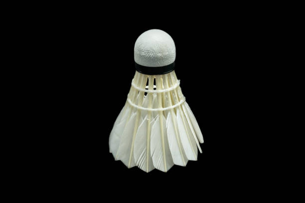 badminton ball on black background - shuttlecock stock pictures, royalty-free photos & images