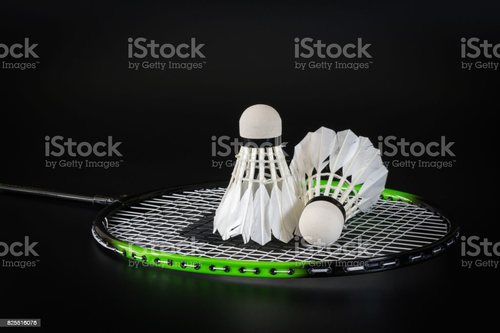 Badminton ball on the badminton racket stock photo