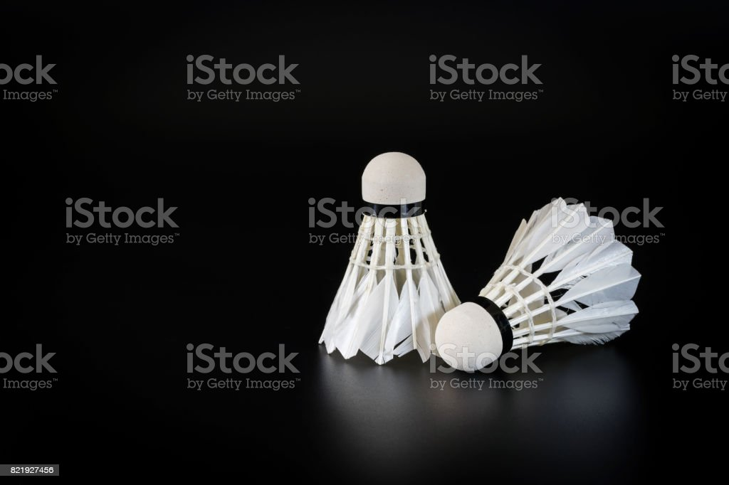 Badminton balls over black background stock photo