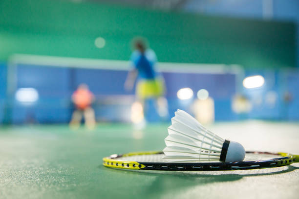 Badminton courts with players competing Asia, Badminton - Sport, Activity, Competition, Equipment badminton stock pictures, royalty-free photos & images