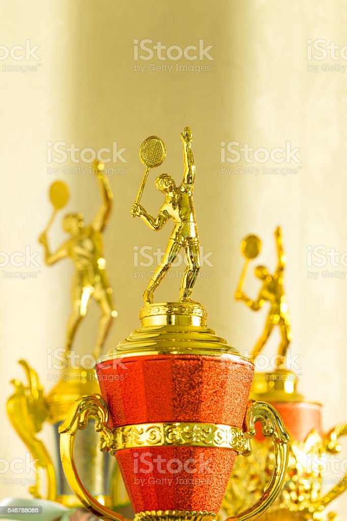 Badminton gold color trophies stock photo