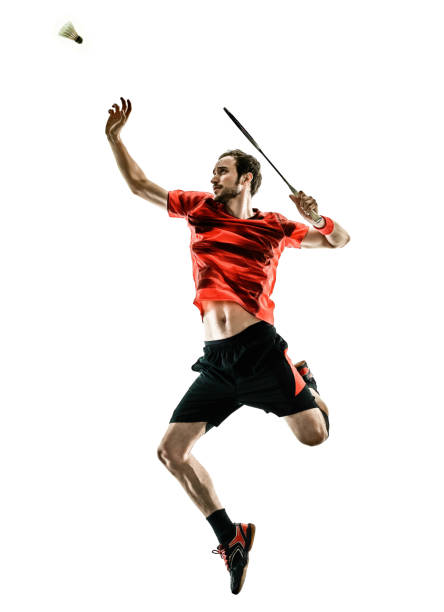 Badminton player man shadow silhouette isolated white backgroun one caucasian Badminton player man in studio shadow silhouette isolated on white background badminton stock pictures, royalty-free photos & images