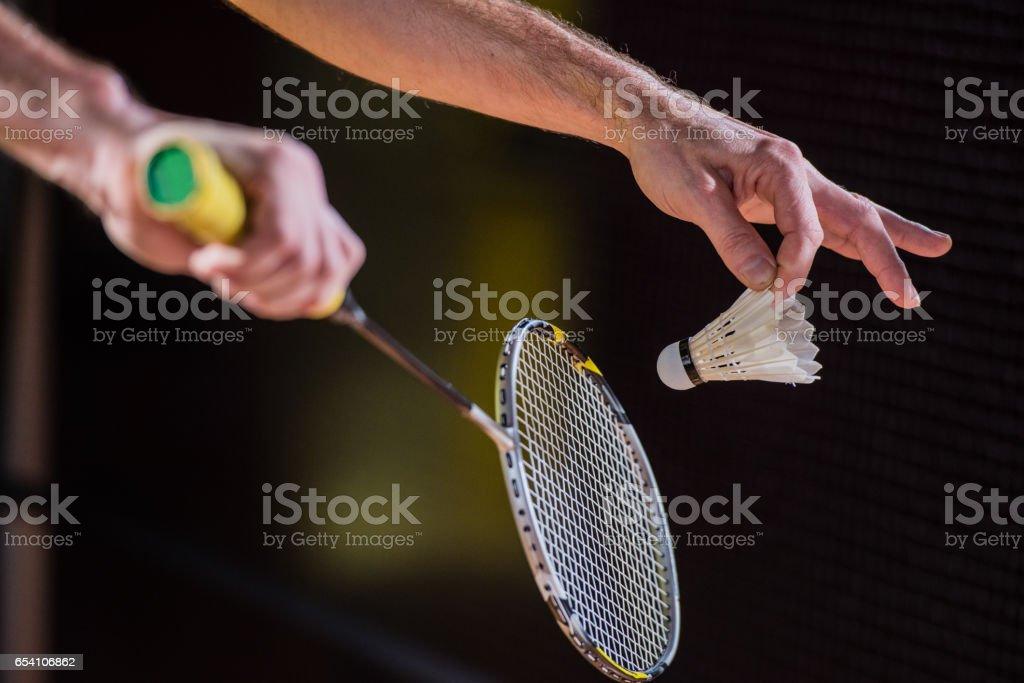 Badminton player serving stock photo