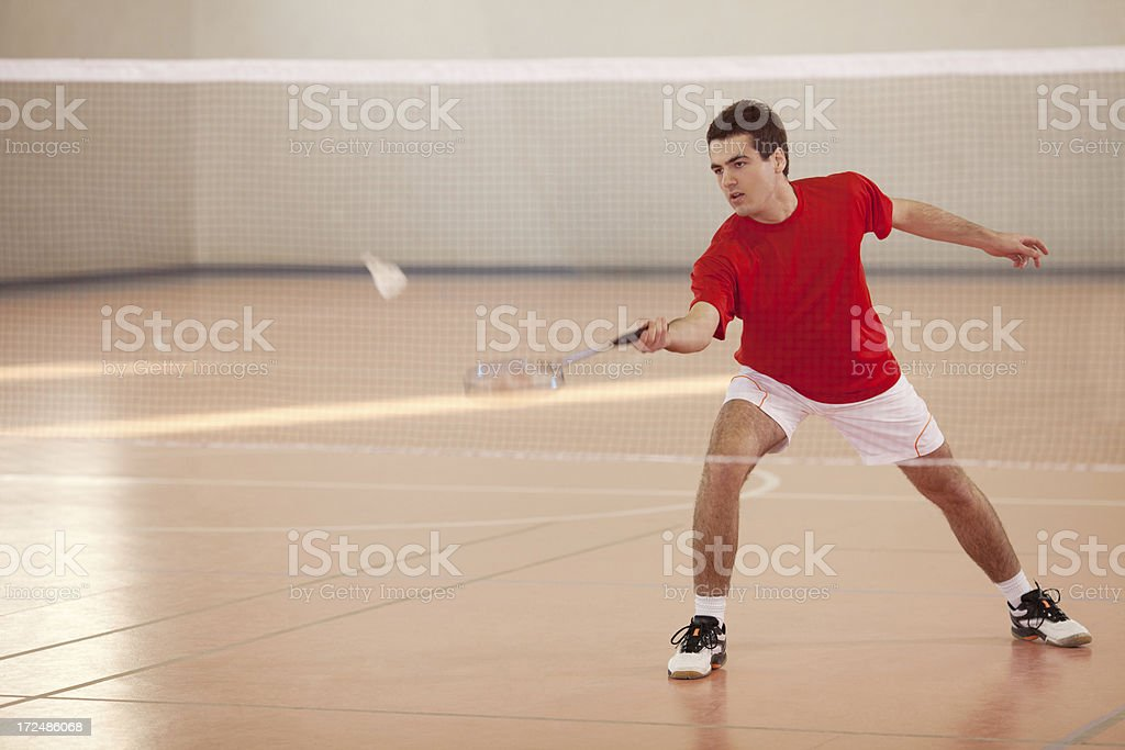 Badminton player with a racket in his hand hit shuttlecock stock photo